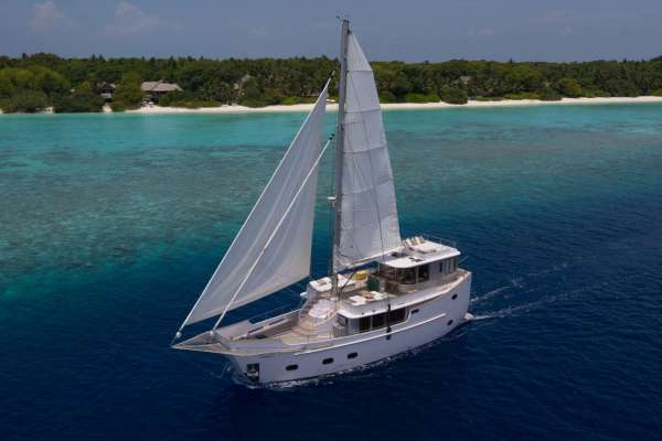 Aerial view on the luxury yacht Soneva con Aqua at the coastline of Kunfunadhoo Island