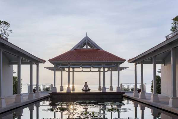 A hotel guest practitioning morning yoga  at Amatara Phuket