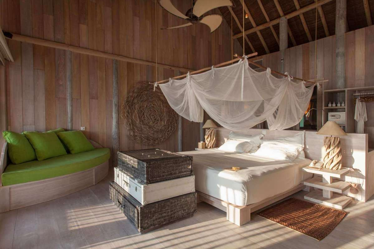 The interior of the guest Bedroom of Villa One at Soneva Fushi