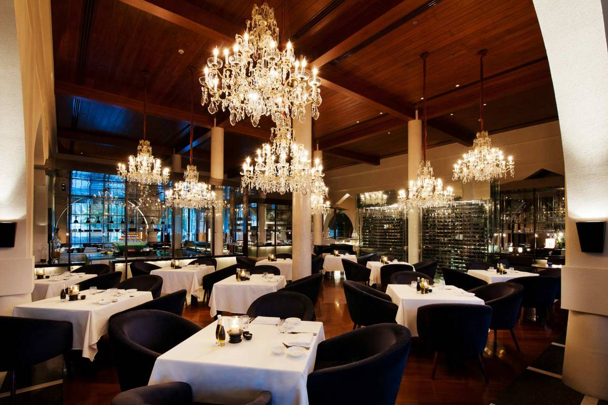 View on the tables of The Restaurant and the chandeliers