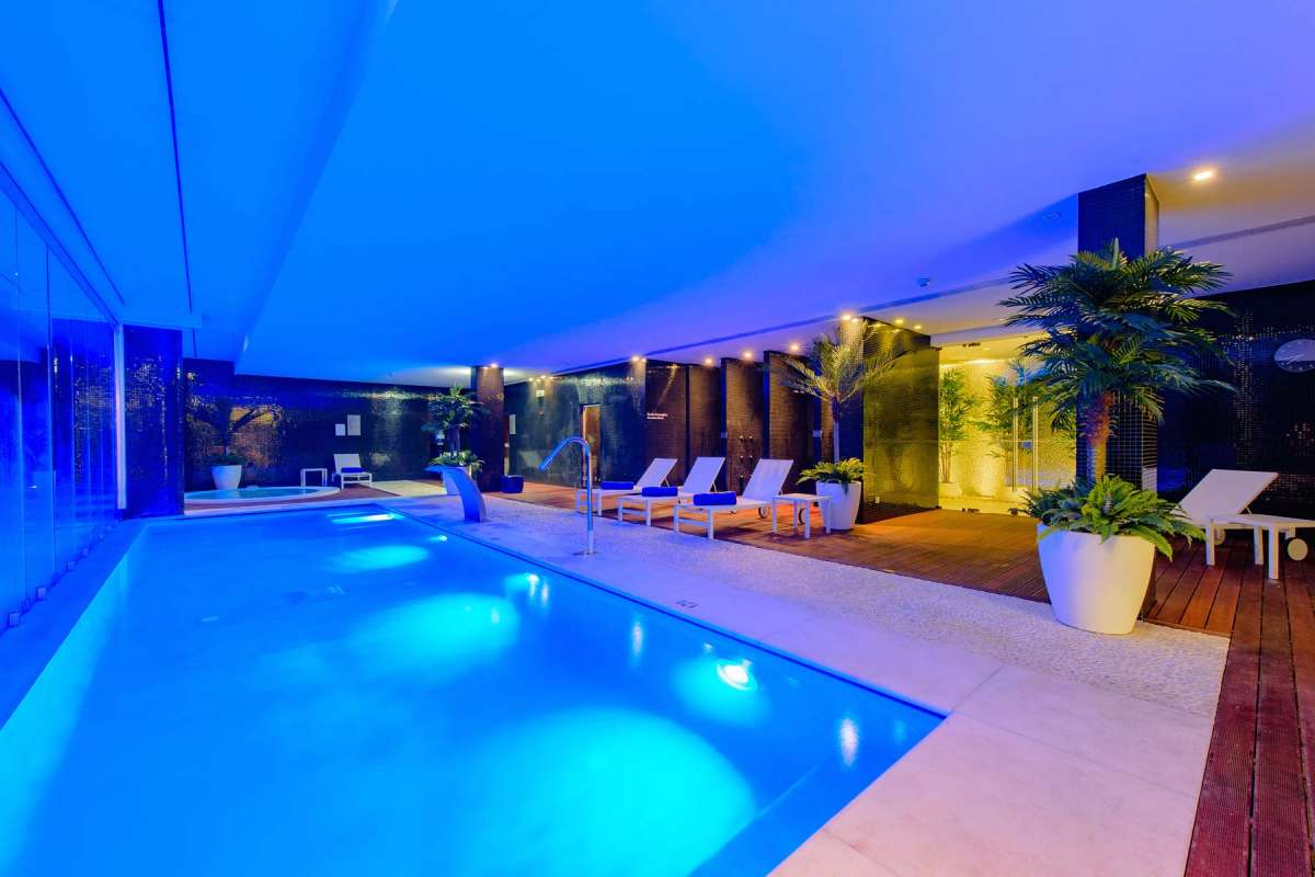 View on the illuminated indoor pool at Martinhal Cascais