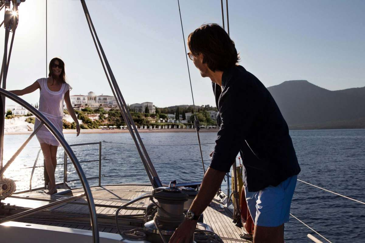 A couple enjoying their stay on a sailing yacht