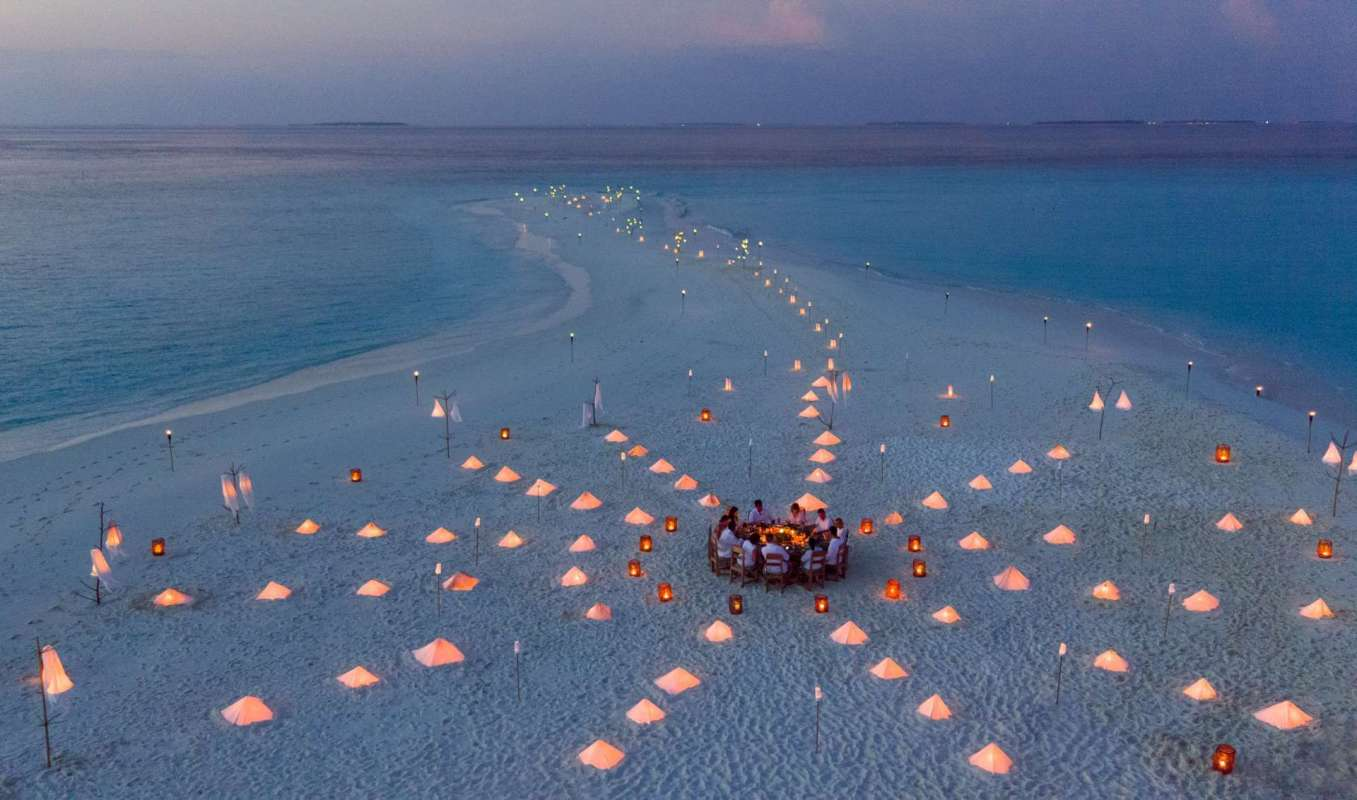 View on a private Diner on a sandbank with hotel guests of Soneva Fushi
